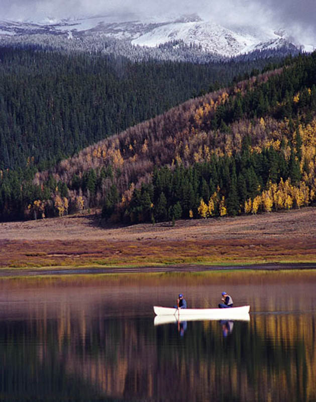 Canoe reflecting in Spring Creek Reservoir, CO.
