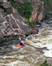 Kayakers on the Cache la Poudre Scenic Byway near Ft Collins, Colorado.